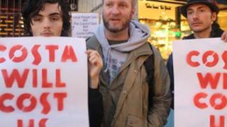 Protesters outside the Costa Coffee shop in Gloucester Road
