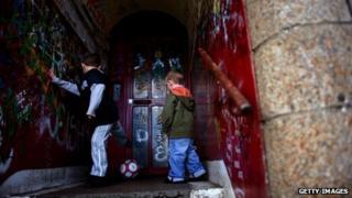 Boys in run-down Glasgow street