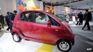 "This 5 January 2010 file photograph shows visitors as they inspect Tata Motor's cheapest car ""Nano"" at Pragati maidan during the 10th Auto Expo 2010 in New Delhi."