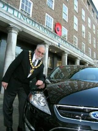 Nottinghamshire County Council chairman Keith Walker leans on a civic car