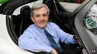 Chris Huhne sitting in a car