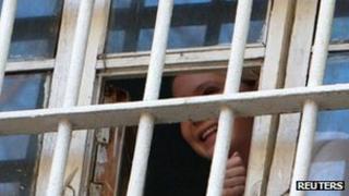 Ukrainian ex-Prime Minister Yulia Tymoshenko looks out of her prison cell bars in Kiev, 4 November