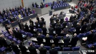 German MPs observe a minute's silence for victims of the killings, 22 November