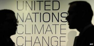 Silhouetted people at climate change talks