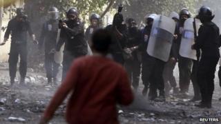 A protester faces riot police in Cairo, Egypt - 22 November 2011