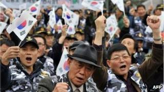 South Korean veterans and conservative activists wave the national flag during an anti-North Korea rally in Seoul on November 18
