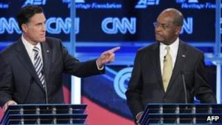Former Massachusets governor Mitt Romney (L) and US businessman Herman Cain (R) during the Republican presidential debate on national security in Washington - 22 November 2011