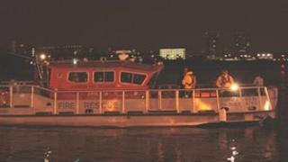 London Fire Brigade searching for a body reportedly in the River Thames.