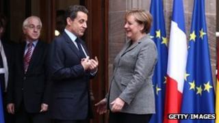 French President Nicolas Sarkozy with German Chancellor Angela Sarkozy (24 Nov 2011)