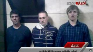 Images of the three American students broadcast on Egyptian state TV on 22 November 2011