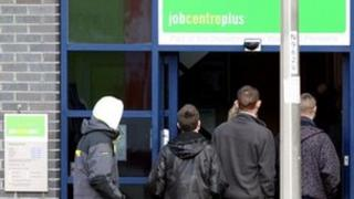 Young men enter a Job Centre