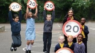 Children with 20mph signs