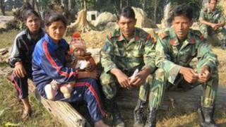 Maoist fighters and their families
