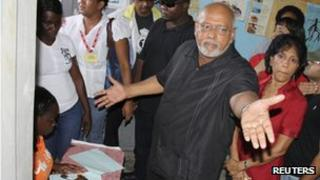Donald Ramotar, Presidential Candidate of incumbent People's Progressive Party/Civic (PPP/C), and his wife Deomattie at a polling station in Georgetown 28 November 2011.