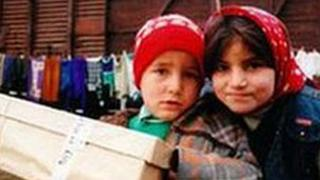 Children with shoe box gift