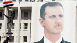 A giant portrait of embattled Syrian President Bashar al-Assad hangs on a building in the capital Damascus on November 28, 2011.