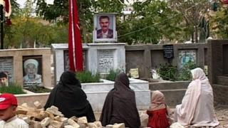 Members of the Hazara community at a Quetta graveyard