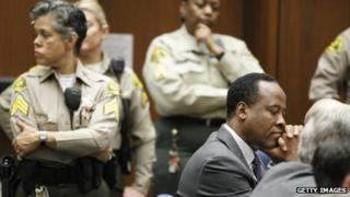 Dr Conrad Murray closes his eyes after he is sentenced