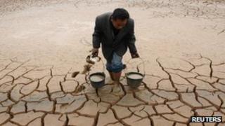Farmer carrying water in Yingtan, Jiangxi province