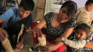 Family in Peru's capital, Lima, preparing popcorn to sell in the shantytown of Pamplona Alta