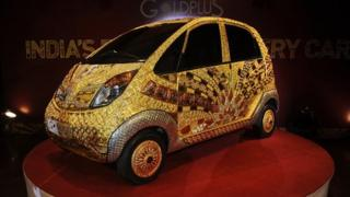 "A custom Tata Motors ""Nano"" car adorned in gold, silver and gemstone trimmings"