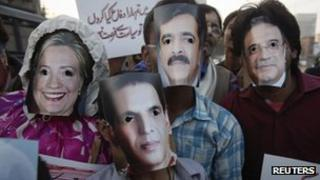 Protesters in Lahore wear masks representing American and Pakistani leaders
