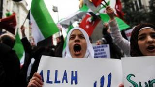 Syrians living in Turkey chant slogans and wave flags during a protest against the government of President Assad in front of the Syrian consulate in Istanbul, on November 25, 2011