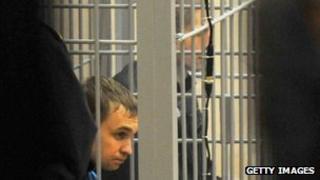 Dmitry Konovalov (L) and Vladislav Kovalyov (R), appear for sentencing at the Supreme Court in Minsk, 30 November 2011