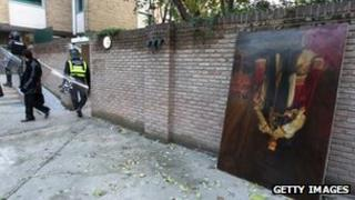A royal portrait is dumped outside the British embassy in Tehran, 29 November 2011