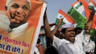 Supporters of Indian rights activist Anna Hazare shout slogans during a rally in support of Mr Hazare's fight against corruption, in Mumbai, Aug 2011