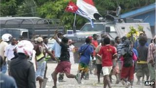 Papuan demonstrators wave the banned Morning Star Flag flag in Timika on December 1