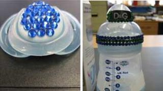 Dummy with 'jewels' glued to the back of it and baby bottle with 'jewels' glued to the rim and lid