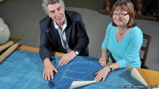 Dr Robb Robinson and Jean Cannon holding the blueprints