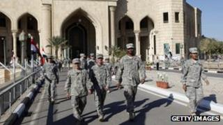 US soldiers leave al-Faw palace at Camp Victory in Iraq, 1 December 2011