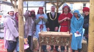 People dressed as shepherds with Midsomer Norton mayor Paul Myers