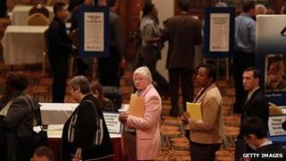 Job seekers wait in line to meet with a recruiter at a job fair in San Francisco, California, on 9 November 2011
