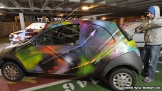 Car covered in graffiti. Photo by Ewen Weatherspoon