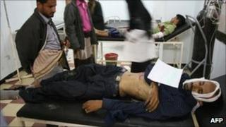 Wounded anti-government protesters at a hospital in the second largest city, Taez, on 2 December
