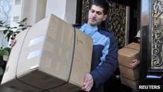 Delivery men take boxes from the embassy