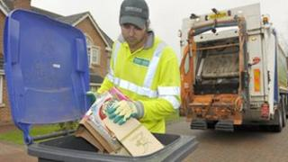 Man using recycling bins