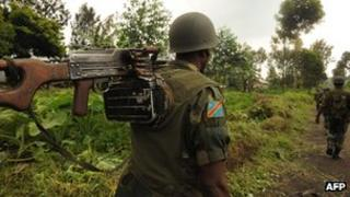 Congolese soldiers patrol the town of Saki, west of Goma, on 29 November 2011