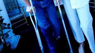 Patient using crutches