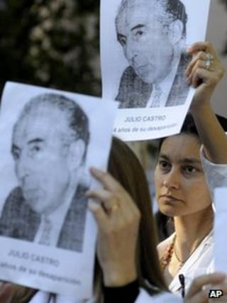 Teachers stage a demonstration on 2 December 2011 holding aloft photos of Julio Castro