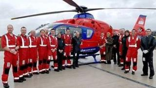 Judi and the Air Ambulance team in front of one of the aircraft
