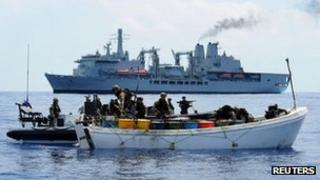 A Royal marines team boarding a suspected pirate vessel in the Indian Ocean on 28 November 2011.