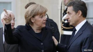 German Chancellor Angela Merkel with French President Nicolas Sarkozy (5 Dec 2011)