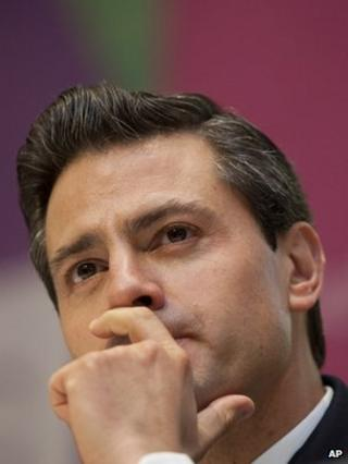 Enrique Pena Nieto pauses at a news conference where he stumbled to remember books or authors that had influenced him.