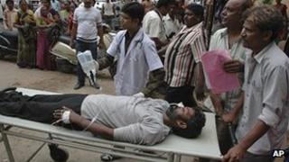 A hooch tragedy victim being taken to hospital