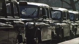 Black cabs on a street