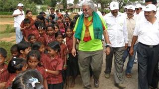 Pushpanath Krishnamurthy walks with school kids in Karnataka